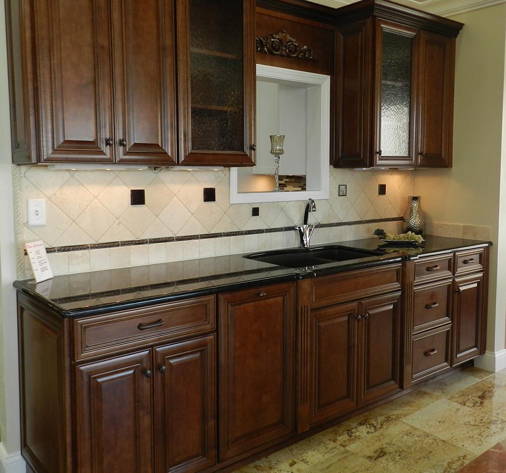 Dark Wood Cabinet Kitchen With Black Marble Counter Tops Newline Design Center Newline Design Center