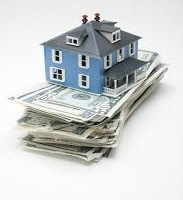 Image of blue home ontop of cash